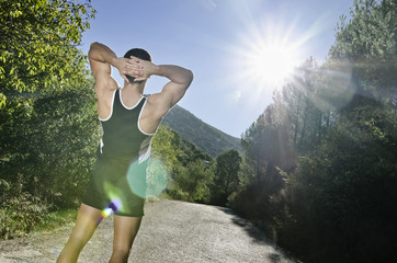 Runner warming legs with sun lens flare