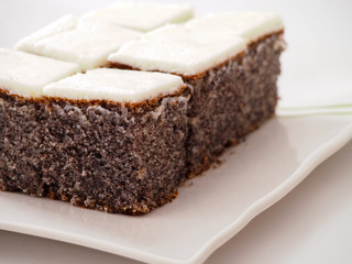 Poppy seed cake with cream frosting