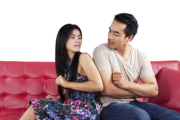 Couple having conflict on couch