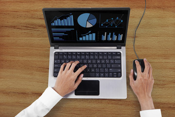 Entrepreneur hands working with laptop