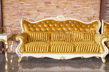Beautiful vintage sofa next to wall