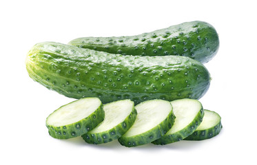 Two cucumbers and pieces isolated on white