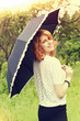 red-haired girl and umbrella