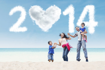 Happy family celebrate new year at beach