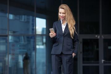 beautiful businesswoman writing sms