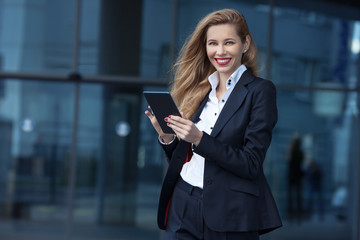 beautiful businesswoman with tablet