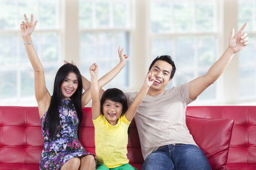 Joyful family expressing happy at home