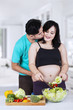 Man kiss his pregnant wife