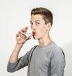attractive  caucasian teenage boy drinking water