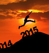Silhouette man jumping over 2015