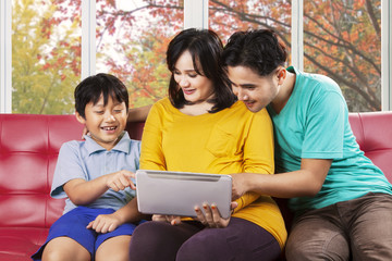 Son and his parents using tablet