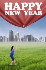 Woman and a banner of new year