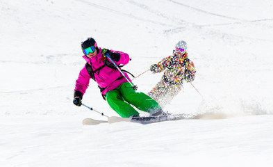 Two Skiers on mountain slope off piste