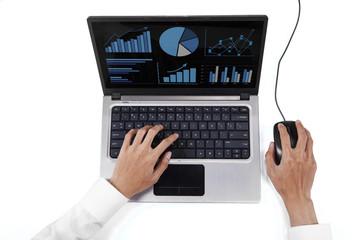 Worker using laptop to analyze chart