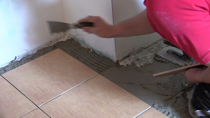 professional work at home interior floor tiling