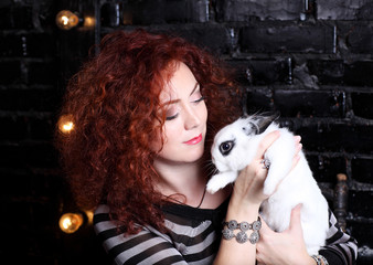 Young woman holding white rabbit