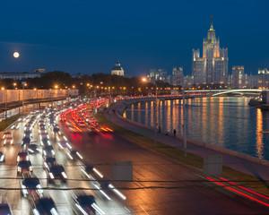 Traffic on Moskvoretskaya waterfront on the background of Stalin