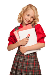 little girl wearing plaid dress holding copy-book and pencils