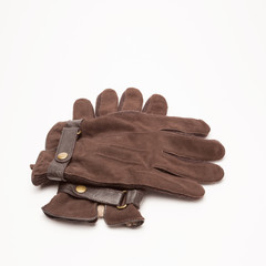 Brown velvet gloves isolated on white
