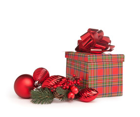 red christmas present with bow, mistletoe and toys