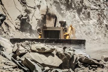 Bulldozer doing road construction in Himalayas