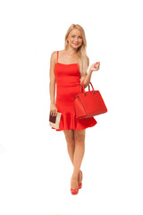 blonde girl wearing red dress holding big bag and documents