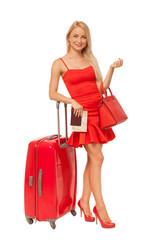 beautiful blonde woman wearing red dress holding big bag, docume