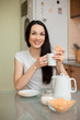 girl drinking tea with cookie in the moring