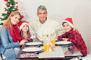 Happy caucasian family celebrating Christmas at the table