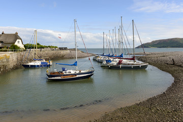 old boats moored in little bay at Porlock Weir, Somerset