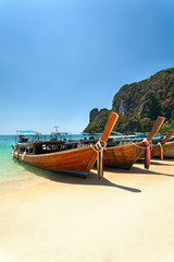 wooden boat and sandy beach.