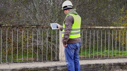 Engineer filmed with tablet PC bridge defence barriers