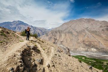 Photographer taking photos in Himalayas