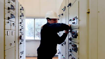 engineer unlocks electrical equipment from control panel
