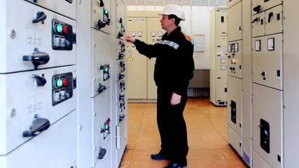 engineer deactivates electrical equipment from control panel