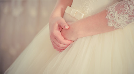 bride arms on a wedding dress