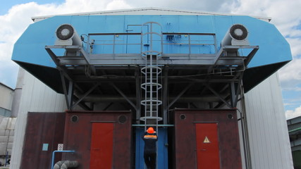 worker climbs by ladder to unit on gas compressor station
