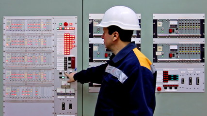 engineer comes to checking light indication on two control panel
