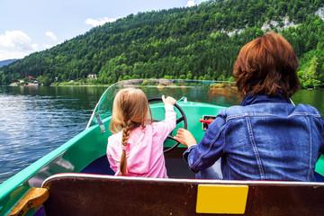 Little girl driving rental boat