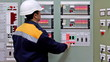 engineer checks indication on panel control of gas in premises