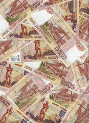 Heap of russian five thousand rubles banknotes