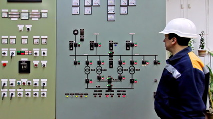 engineer checks indication on panel high-voltage power supply