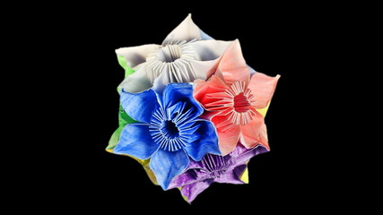 slow rotating of colorful origami kusudama, black background