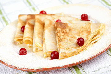 Pancakes with cranberry berries on a plate