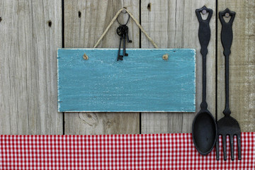Blank antique blue wood menu sign with cast iron spoon and fork