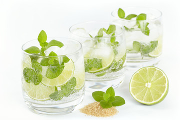 Three glasses with Mojito cocktail on a white background
