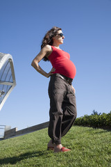 pregnant woman on top of hill