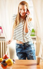 Teenage girl talking on cellphone