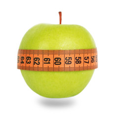 Green apple and orange measuring tape