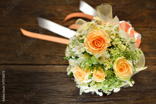 canvas print picture Beautiful bouquet of flowers on wooden background